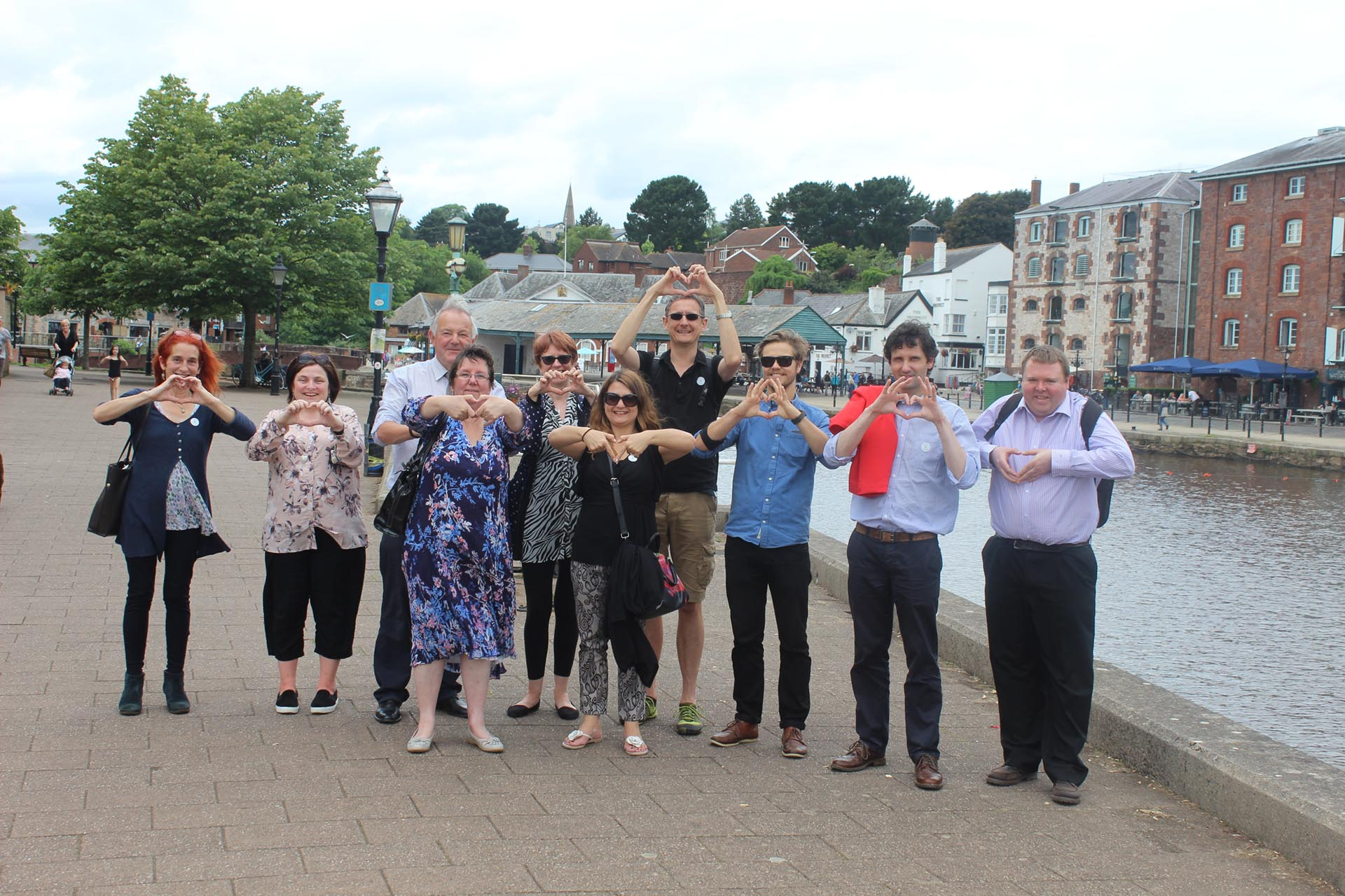 DCT team LOVE Devon hand sign