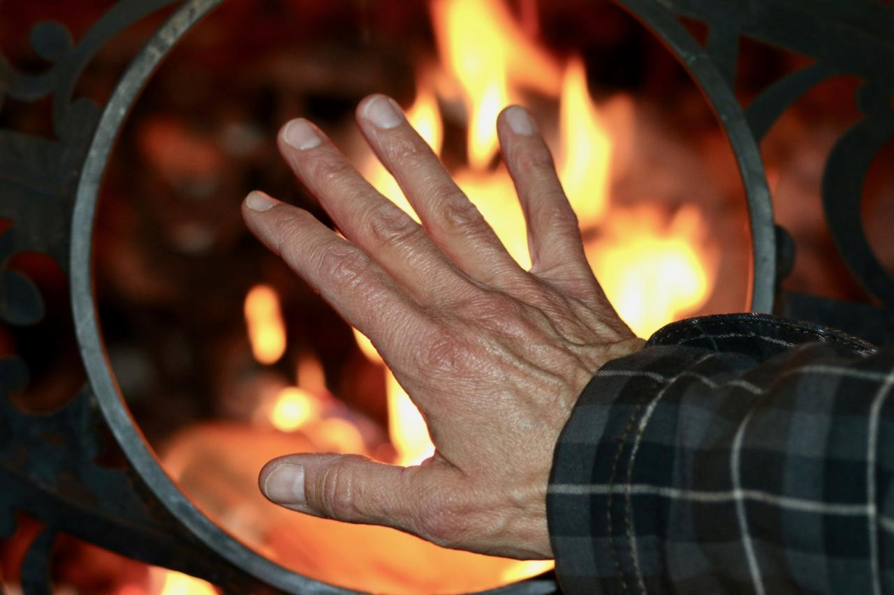 Warming hands by fire