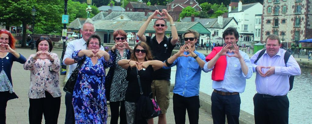 DCT Team making the LOVE Devon hand sign