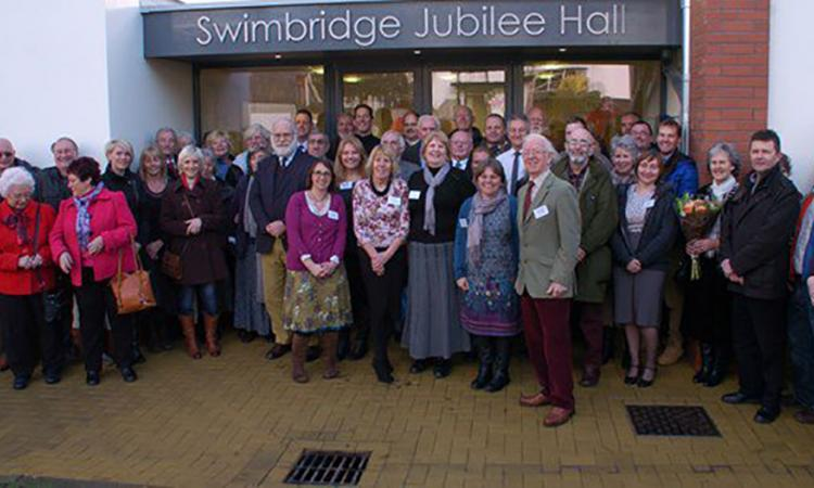 People standing outside Swimbridge village hall