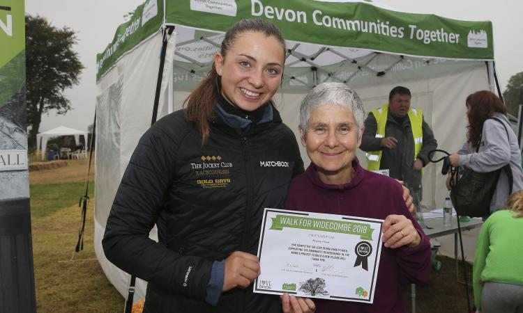 teresa Butchers receives her certificate from Bryony Frost