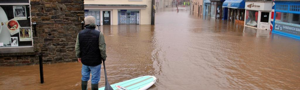 man on surfboard during a flood